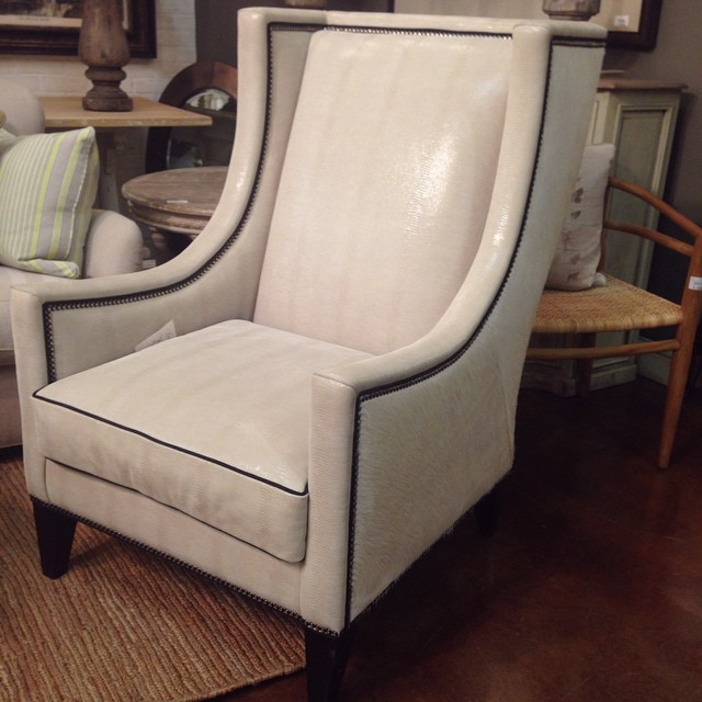 Over the top mix of fabrics but still a simple and modern silhouette. Beautiful. Faux fur on the sides if you can't tell. #fauxfur #nailheadtrim #ostrich #white #pretty #chair #modern #lovely #laurieshomefurnishings