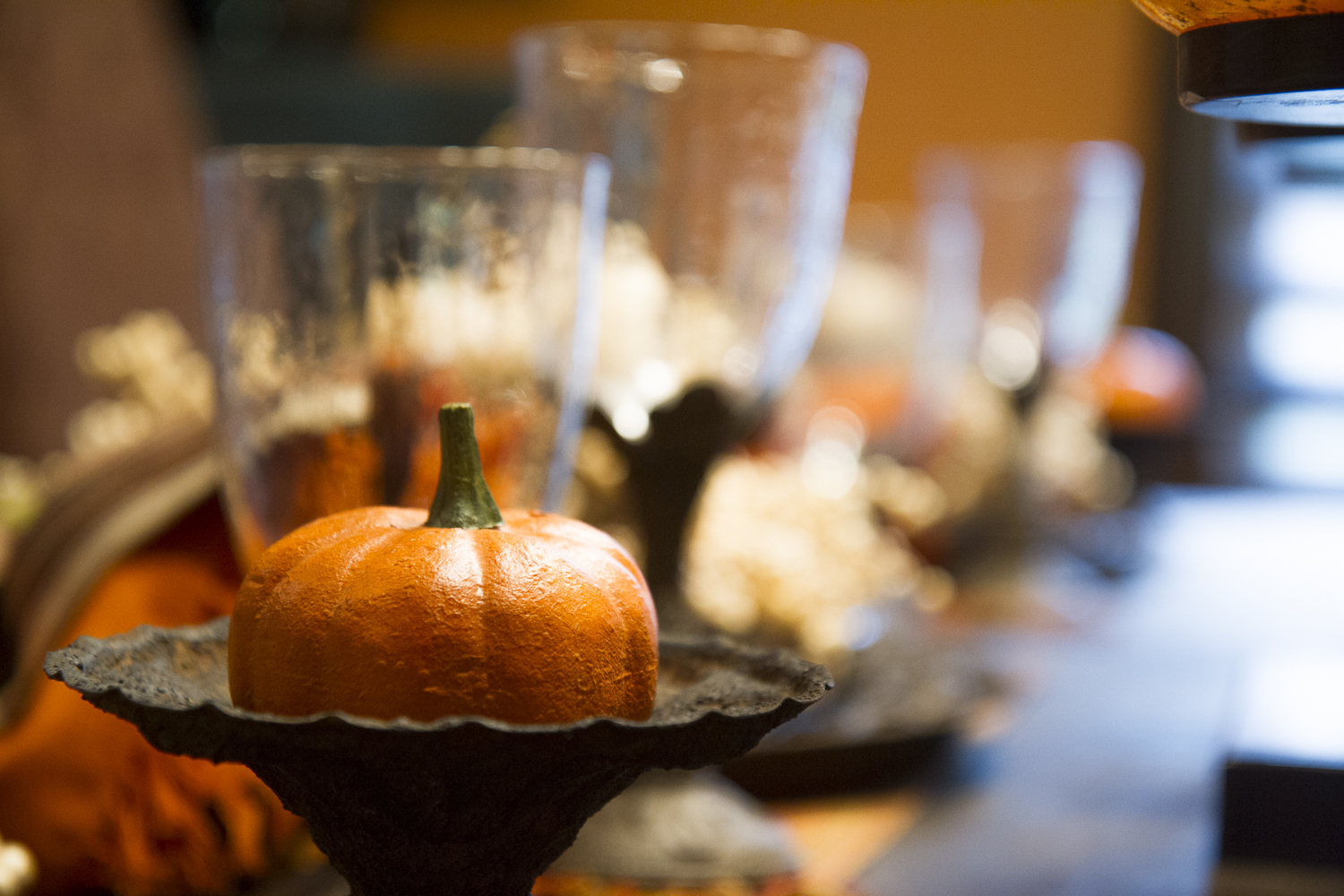 thanksgiving table setting with pumpkin